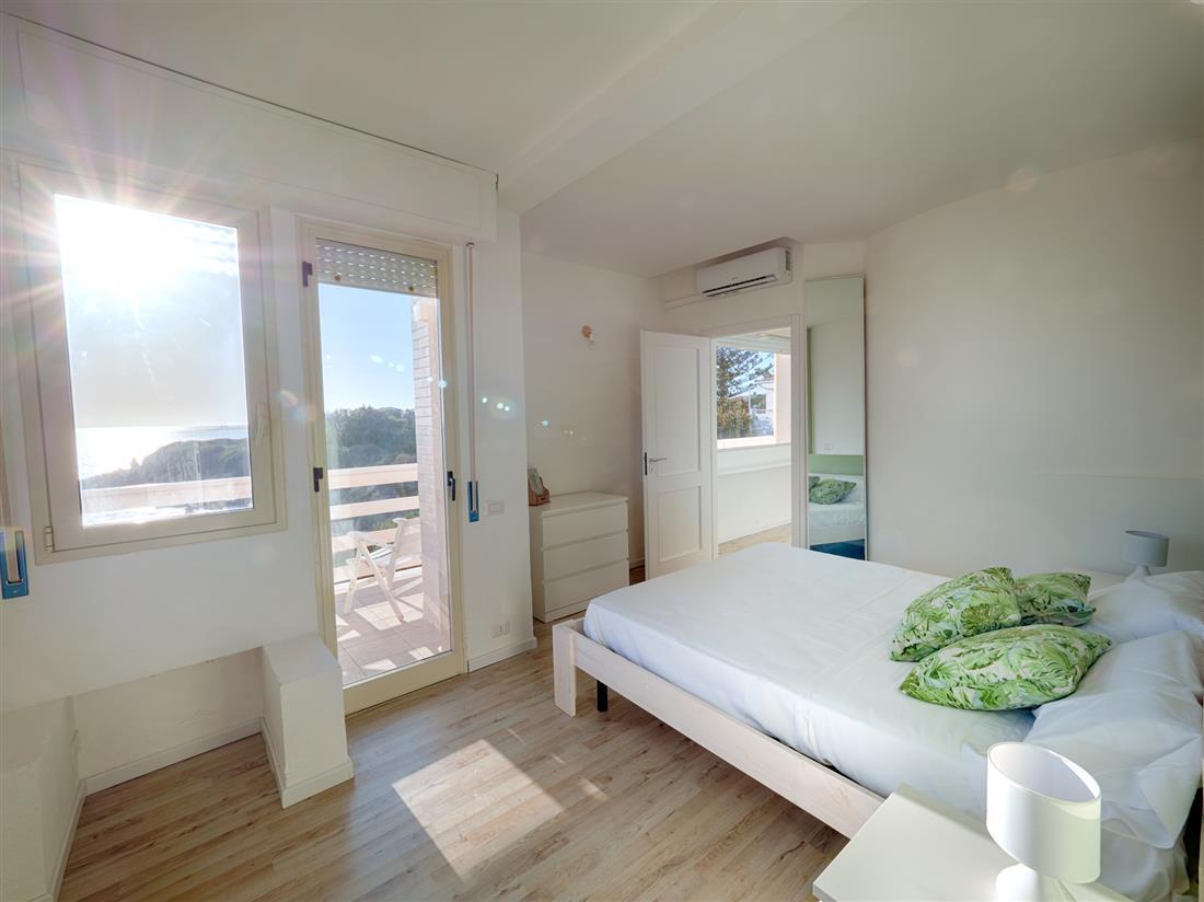 appartamento-camera-da-letto-fronte-mare